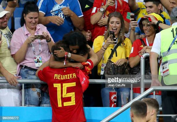 Deborah Panzokou is joined by her partner Thomas Meunier of Belgium while Noemie Happart Carrasco wife of Yannick Carrasco looks on following the...
