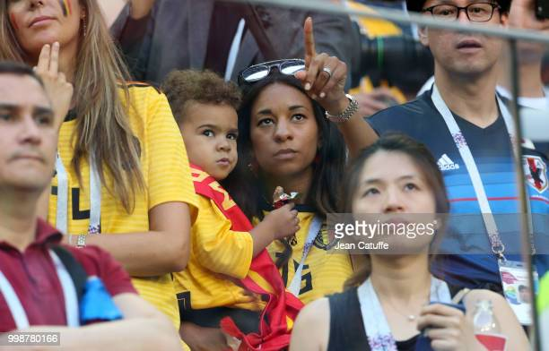Deborah Panzokou partner of Thomas Meunier of Belgium celebrates with their son the victory following the 2018 FIFA World Cup Russia Third Place...