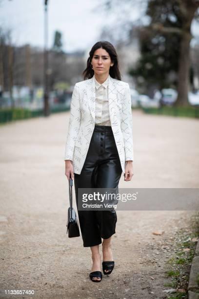 Deborah Reyner Sebag is seen wearing black cropped pants white blazer with print outside Akris during Paris Fashion Week Womenswear Fall/Winter...