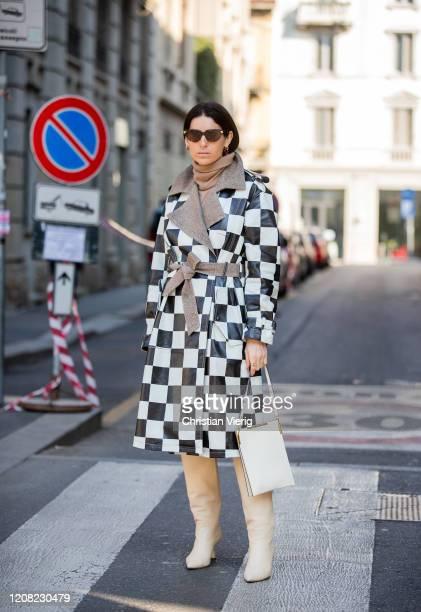 Deborah Reyner Sebag is seen wearing black white checkered coat outside Bally during Milan Fashion Week Fall/Winter 2020-2021 on February 22, 2020 in...