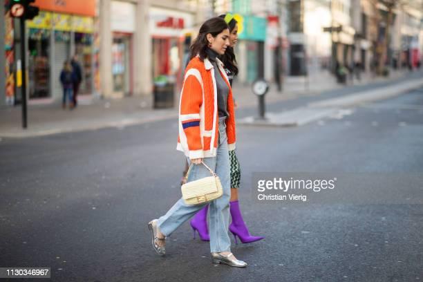 Deborah Reyner Sebag is seen wearing Fendi bag orange jacket grey turtleneck denim jeans outside Natasha Zinko during London Fashion Week February...