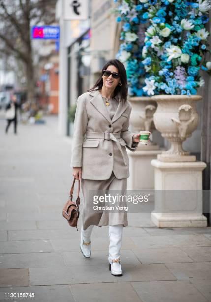 Deborah Reyner Sebag is seen wearing grey belted jacket Prada bag white boots skirt outside AWAKE Awake during London Fashion Week February 2019 on...