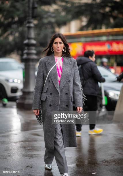 Deborah Reyner Sebag is seen wearing grey coat with fringes outside Alexandre Vauthier during Haute Couture Spring Summer 2019 Day Two on January 22...