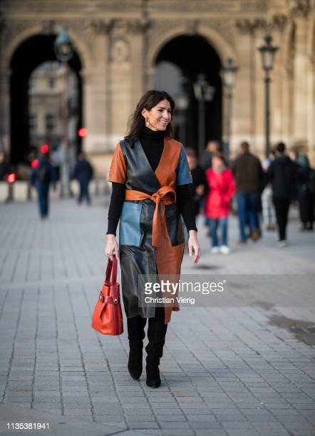 Deborah Reyner Sebag is seen wearing multi tone coat outside Louis Vuitton during Paris Fashion Week Womenswear Fall/Winter 2019/2020 on March 05,...