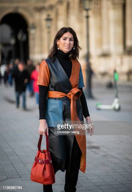 Deborah Reyner Sebag is seen wearing multi tone coat outside Louis Vuitton during Paris Fashion Week Womenswear Fall/Winter 2019/2020 on March 05...