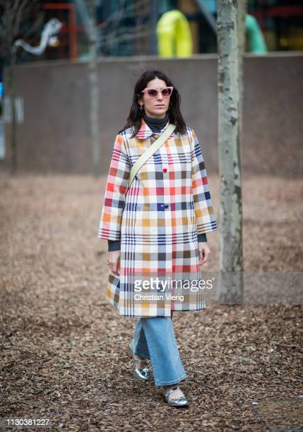 Deborah Reyner Sebag is seen wearing plaid coat outside Burberry during London Fashion Week February 2019 on February 17 2019 in London England