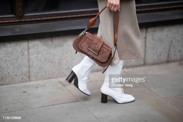 Deborah Reyner Sebag is seen wearing Prada bag white boots skirt outside AWAKE Awake during London Fashion Week February 2019 on February 16 2019 in...