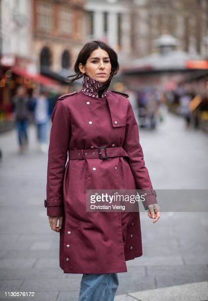 Deborah Reyner Sebag is seen wearing red belted coat denim jeans outside Erdem during London Fashion Week February 2019 on February 18 2019 in London...