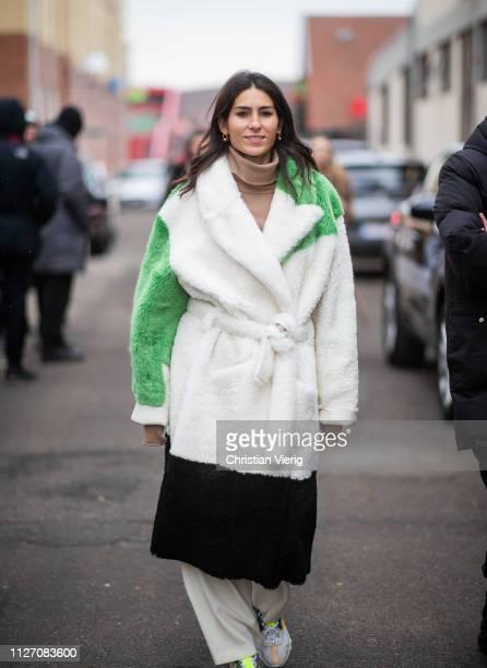 Deborah Reyner Sebag is seen wearing three tone belted teddy coat outside Baum und Pferdgarten during the Copenhagen Fashion Week Autumn/Winter 2019...