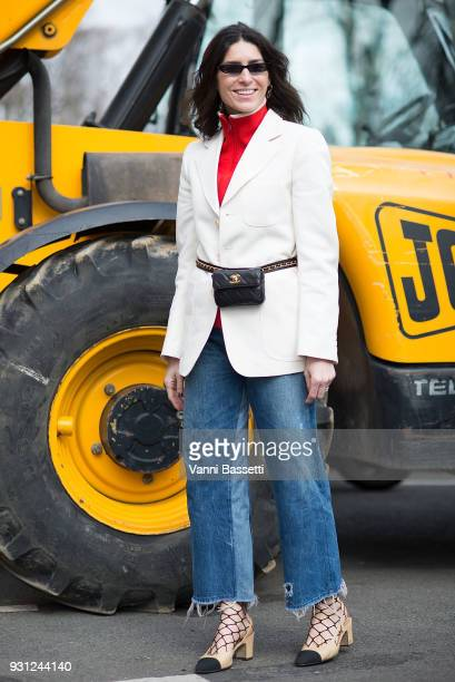 Deborah Reyner Sebag poses with a Chanel waist bag and shoes after the Beautiful People show at the Preau Dutuit during Paris Fashion Week Womenswear...