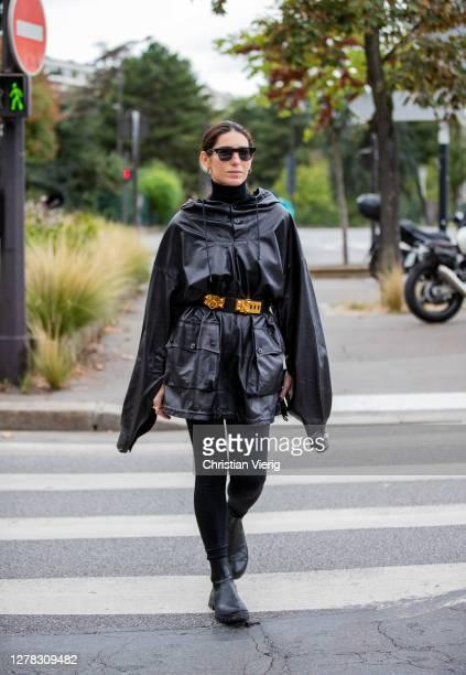 Deborah Reyner Sebag seen wearing black cape and belt outside Hermes during Paris Fashion Week - Womenswear Spring Summer 2021 : Day Six on October...