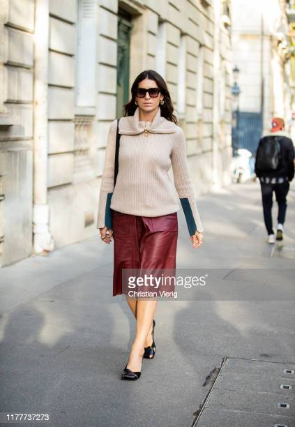 Deborah Reyner Sebag seen wearing bordeaux leather shorts creme white knit with zipper outside Alessandra Rich during Paris Fashion Week Womenswear...