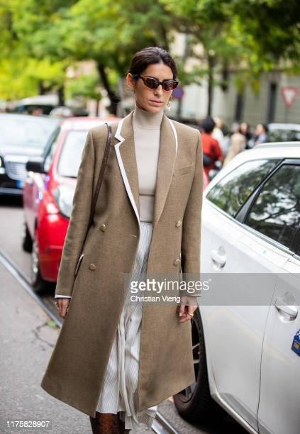 Deborah Reyner Sebag seen wearing brown coat, turtleneck, pleated skirt outside the Fendi show during Milan Fashion Week Spring/Summer 2020 on...