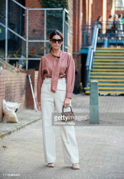 Deborah Reyner Sebag seen wearing salmon colored blouse high waist outside Rocha during London Fashion Week September 2019 on September 15 2019 in...