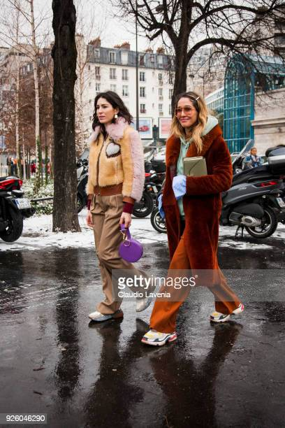Deborah Reyner Sebag wearing a beige fur jacket and brown pants and a guest are seen in the streets of Paris after the Chloe show during Paris...