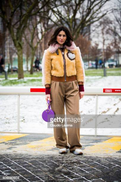 Deborah Reyner Sebag wearing a beige fur jacket and brown pants is seen in the streets of Paris after the Chloe show during Paris Fashion Week...