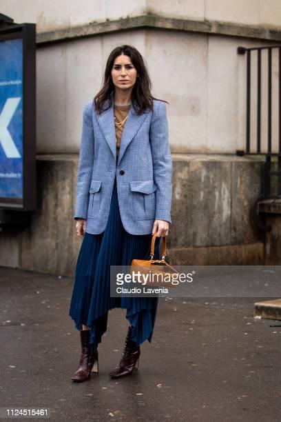 Deborah Reyner Sebag wearing a beige sweater blue long skirt brown boots tan bag and light blue blazer is seen outside Elie Saab show during Paris...