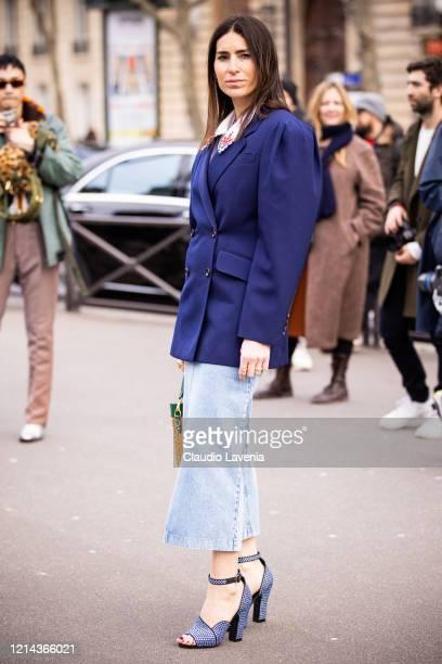Deborah Reyner Sebag, wearing a blue blazer, jeans and blue decorated heels, is seen outside Miu Miu, during Paris Fashion Week - Womenswear...