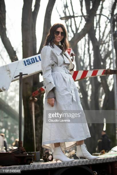 Deborah Reyner Sebag wearing a grey trench coat is seen outside Emporio Armani on Day 2 Milan Fashion Week Autumn/Winter 2019/20 on February 21 2019...