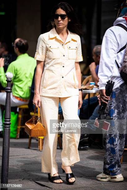 Deborah Reyner Sebag wearing a light yellow shirt with matching pants black sandals and tan leather bag is seen outside OffWhite fashion show on Day...