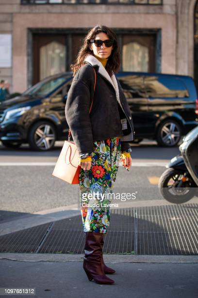 Deborah Reyner Sebag wearing a printed dress dark grey jacket with fur details burgundy boots and red bag is seen outside Schiaparelli during Paris...