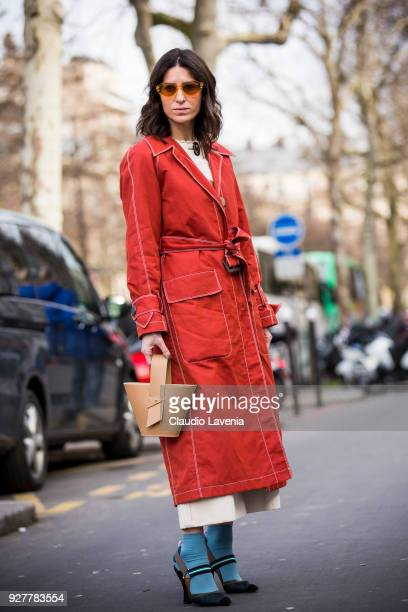 Deborah Reyner Sebag wearing a red trench is seen in the streets of Paris before the Giambattista Valli show during Paris Fashion Week Womenswear...
