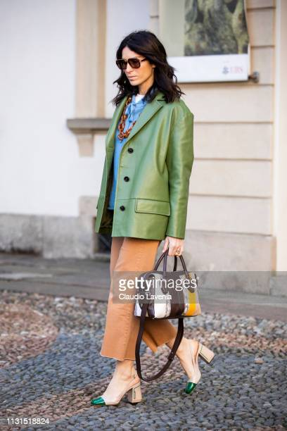 Deborah Reyner Sebag wearing green jacket is seen outside Tod's on Day 3 Milan Fashion Week Autumn/Winter 2019/20 on February 22 2019 in Milan Italy