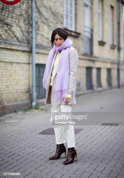 Deborah Reyner Sebag wearing pink scarf checked jacket yellow knit creme white cropped pants seen outside Samsoe Samsoe Autumn 2019 Resee on December...