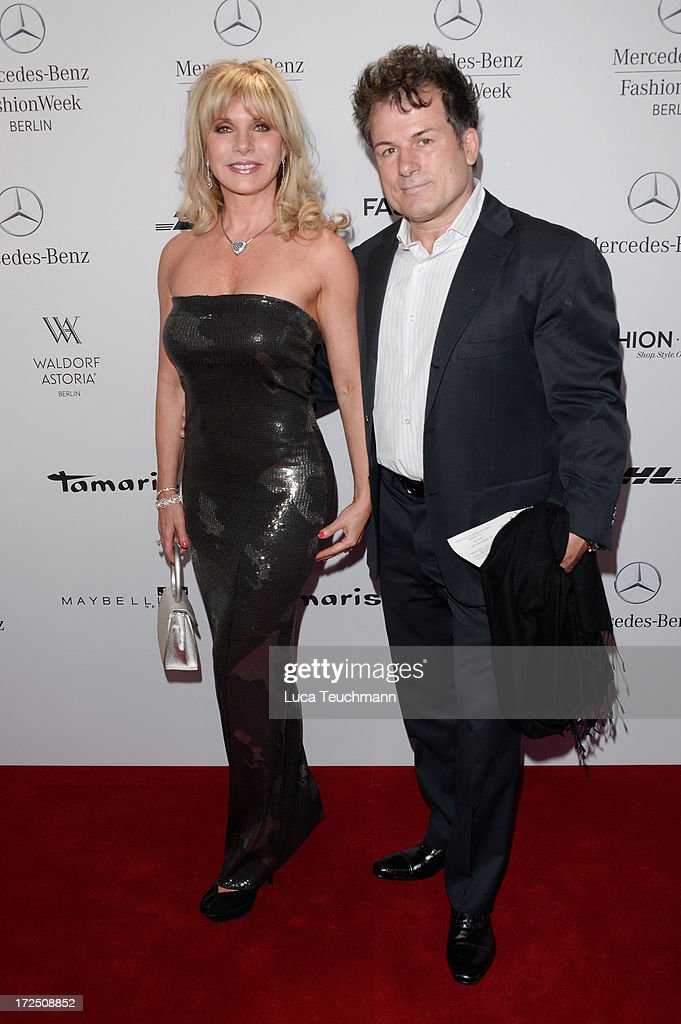 Deborah Sasson and Dieter Tings attend the Riani Show during Mercedes-Benz Fashion Week Spring/Summer 2014 at Brandenburg Gate on July 2, 2013 in Berlin, Germany.