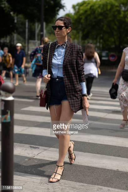 Deborah Sebag is seen on the street during men's Paris Fashion Week wearing maroon grid pattern blazer, blue shirt with leopard print collar, denim...