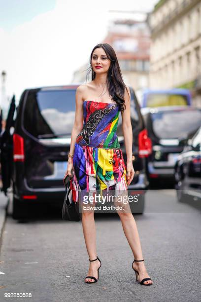 Deborah Valdez Hung wears a multicolor dress outside Elie Saab during Paris Fashion Week Haute Couture Fall Winter 2018/2019 on July 4 2018 in Paris...