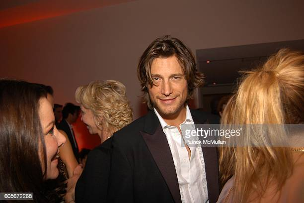 Deborah Waknin and Gabriel Aubrey attend VERSACE VIP Dinner at 1 Beacon Court on February 7 2006 in New York