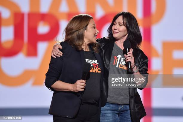 Deborah Waknin and Shannen Doherty speak onstage at the sixth biennial Stand Up To Cancer telecast at the Barkar Hangar on Friday September 7 2018 in...