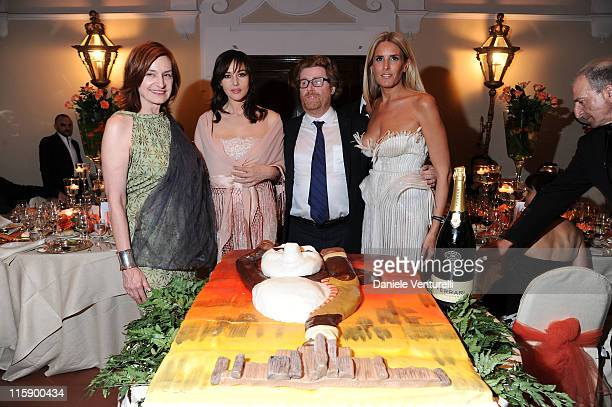 Deborah Young Monica Bellucci Owen Phillips and Tiziana Rocca attend the Opening Gala Dinner during the 57th Taormina Film Fest on June 11 2011 in...