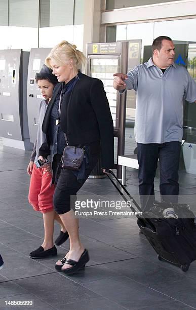 DeborraLee Furness and son Oscar Jackman are seen arriving at El Prat airport on June 18 2012 in Barcelona Spain