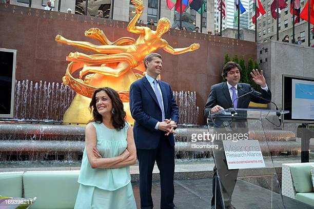 Debra Black, co-founder of the Melanoma Research Alliance, from left, Jeff Rowbottom, head of North American capital markets at KKR & Co., and...
