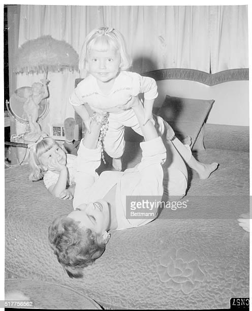 Debra enjoys a beforebedtime tussle with her cute blonde nieces Jeneene and Kim 2