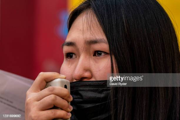 """Debra Erdene becomes emotional while addressing demonstrators in the Chinatown-International District during a """"We Are Not Silent"""" rally and march..."""