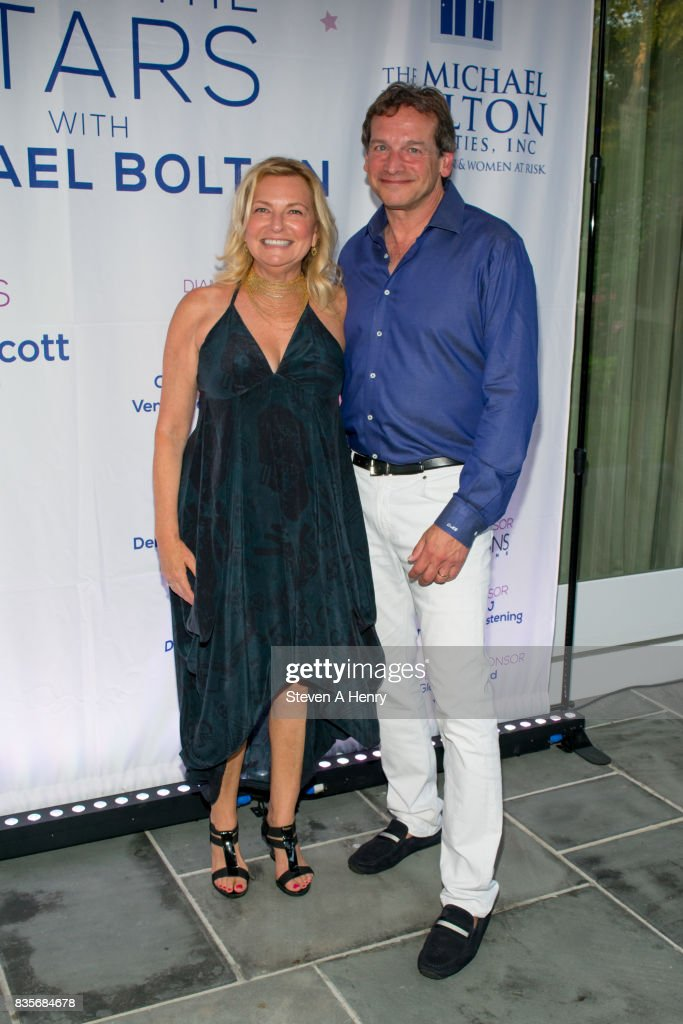 Debra Halpert and David Greenberg attend An Intimate Evening Under The Stars With Michael Bolton at Private Residence on August 19, 2017 in Bridgehampton, New York.
