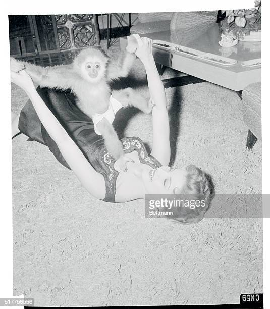 Debra just loves to play with her 16 month old pet gibbon a gift from a friend The tiny simian who wears diapers is one of the many pets in the house