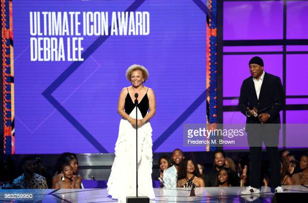 Debra L. Lee accepts the BET Ultimate Icon Award from LL Cool J onstage at the 2018 BET Awards at Microsoft Theater on June 24, 2018 in Los Angeles,...