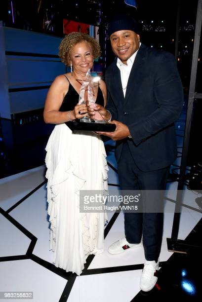 Debra L Lee recipient of the BET Ultimate Icon Award poses with LL Cool J backstage at the 2018 BET Awards at Microsoft Theater on June 24 2018 in...
