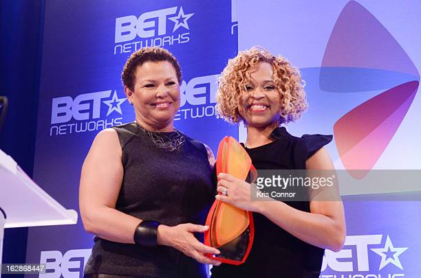 Debra Lee and Esi Eggleston Bracey speak during the Leading Women Defined Dorothy Height Luncheon at Ritz Carlton Hotel on February 28 2013 in...