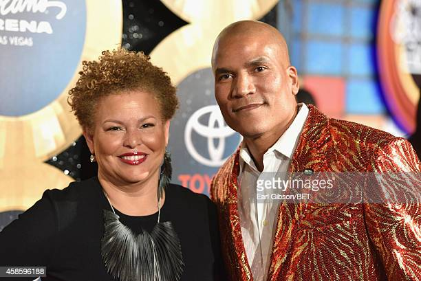 Debra Lee Chairman and CEO of BET and Paxton Baker Executive Vice President and General Manager of Centric attend the 2014 Soul Train Music Awards at...