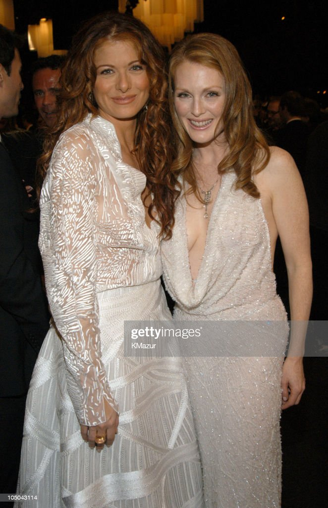 Debra Messing and Julianne Moore during Ninth Annual Screen Actors Guild Awards - Backstage and Audience at The Shrine Auditorium in Los Angeles, California, United States.