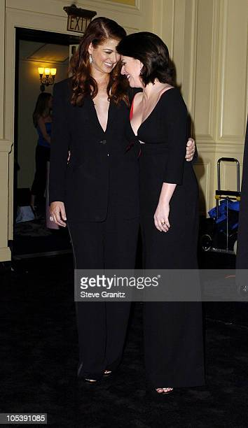Debra Messing and Megan Mullally during 31st Annual People's Choice Awards Press Room at Pasadena Civic Auditorium in Pasadena California United...