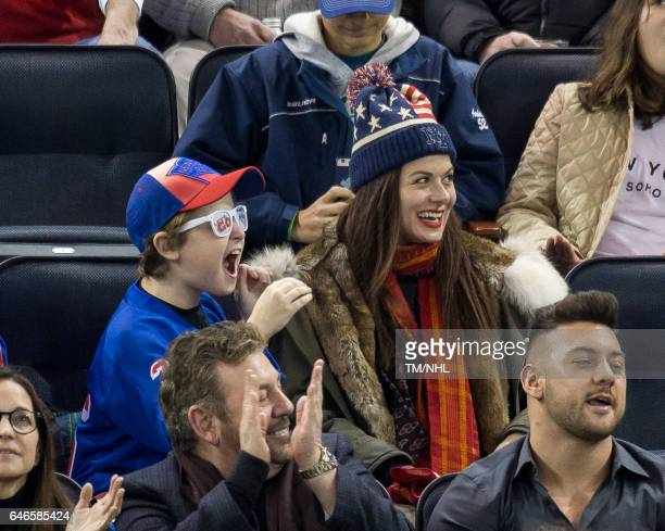 Debra Messing and Roman Walker Zelman are seen at Madison Square Garden on February 28 2017 in New York City
