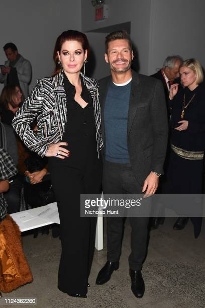 Debra Messing and Ryan Seacrest attend the Naeem Khan front row during New York Fashion Week The Shows at Gallery I at Spring Studios on February 12...