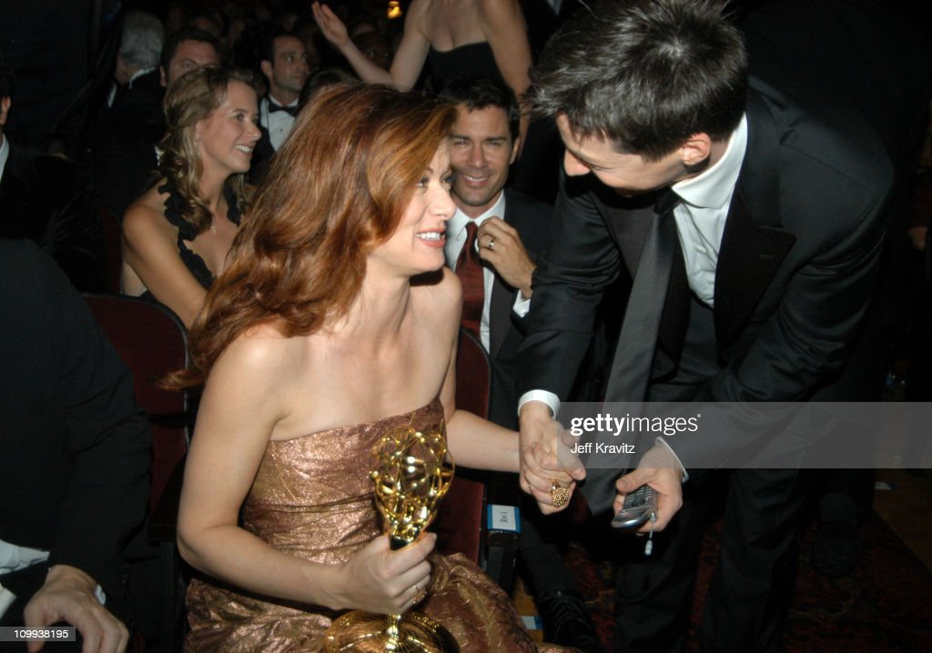 Debra Messing and Sean Hayes during 55th Annual Primetime Emmy Awards - Backstage and Audience at The Shrine Auditorium in Los Angeles, California, United States.