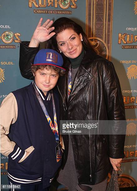 Debra Messing and son Roman Walker Zelman poses at The Opening Night of Cirque du Soleil Kurios Cabinet Of Curiosities at Randall's Island Park on...
